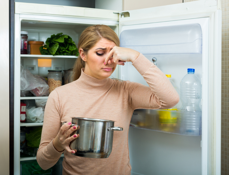 Upset housewife with foul meal