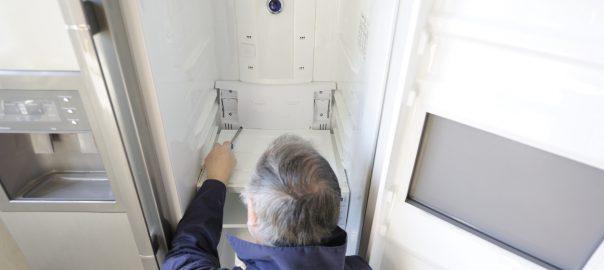 Man Repairing Fridge | Suffolk County Refrigeration Service