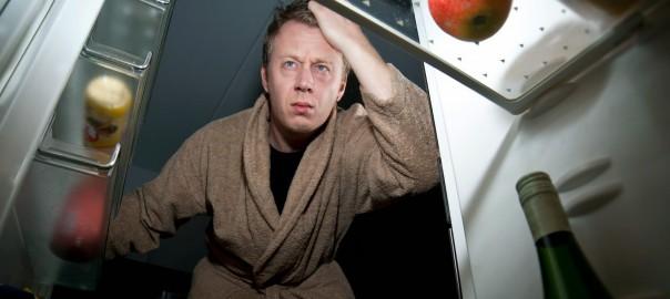 Man Looking for Food at Night | Speedy Refrigerator Service