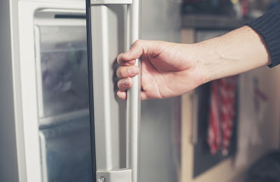 Hand Opening Fridge Door | Refrigeration Service Nassau County