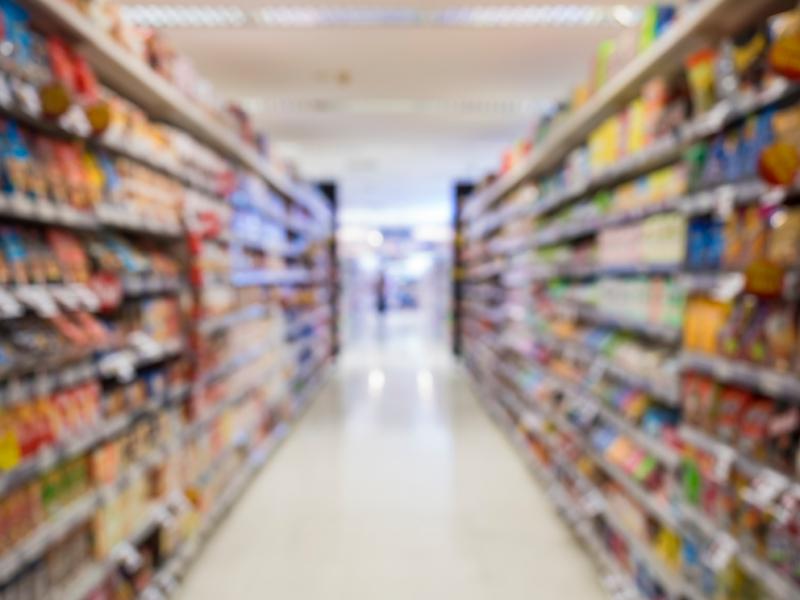 Supermarket shelf Blurred Interior perspective as background