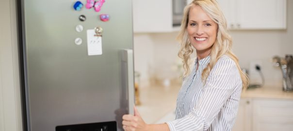 Woman Opening Fridge | Suffolk County Refrigeration Service